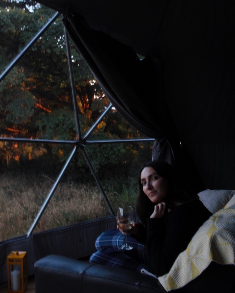 Laura inside Wild Wellingtons glamping dome