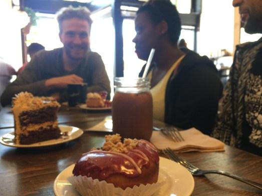 Friends blurry, smiling behind vegan desserts