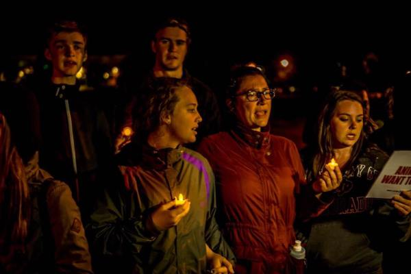 Activist singing songs at night with candles