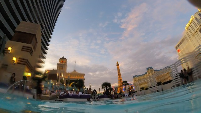 a view from the pool at the cosmopolitan in Las Vegas, Nv. the sky is pink and blue