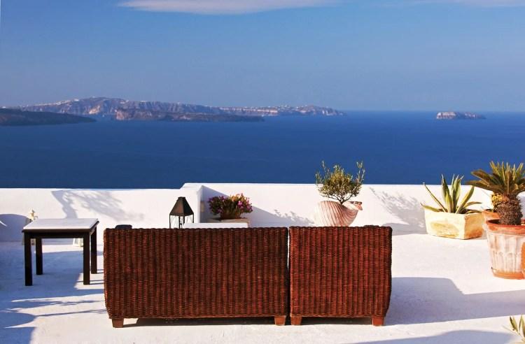 Couch on terrace overlooking Aegean Sea, Oia, Santorini, Greece