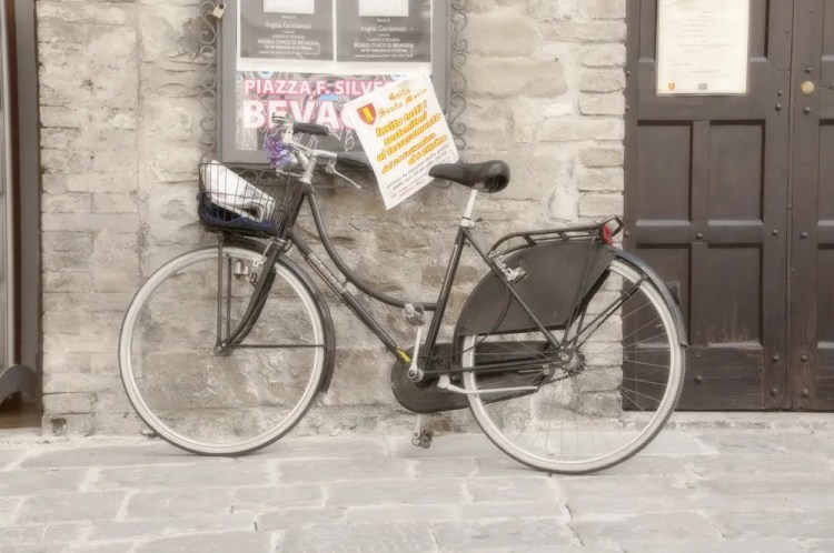 Bike by board with flyers, Bevagna, Italy
