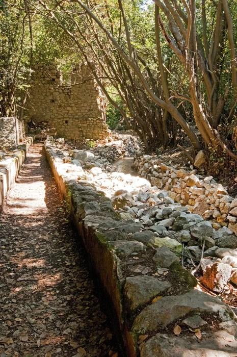 Walkway and stone wall, Olympos, Turkey