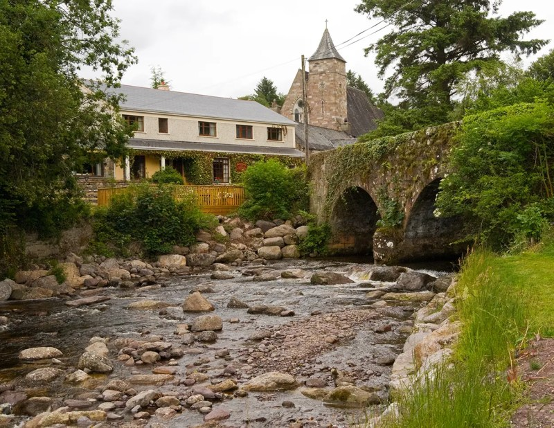 Hanora's Cottage and the Nire River with St Helena's Church