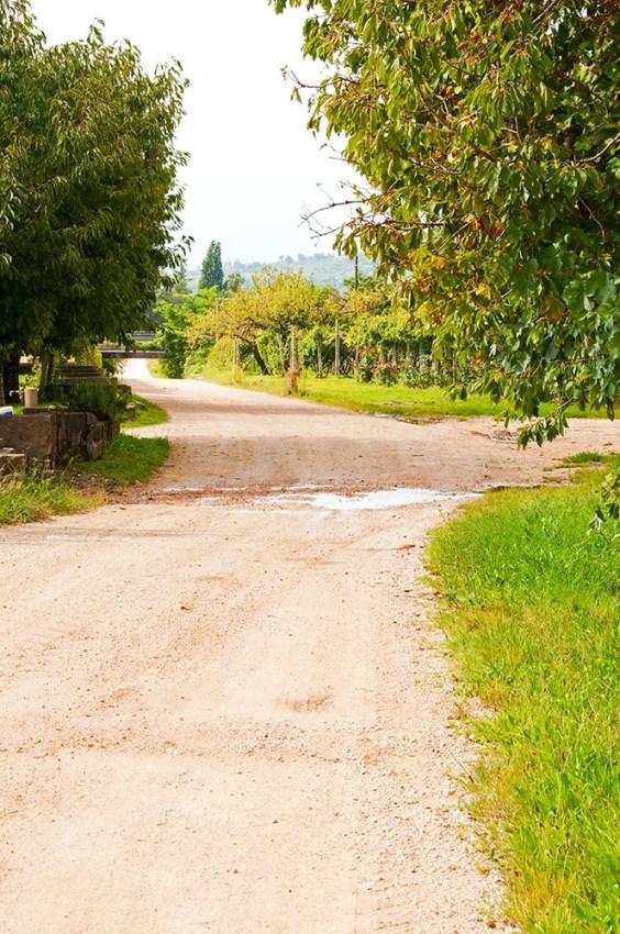 Gravel/dirt road leading to Dimora del Bugiardo