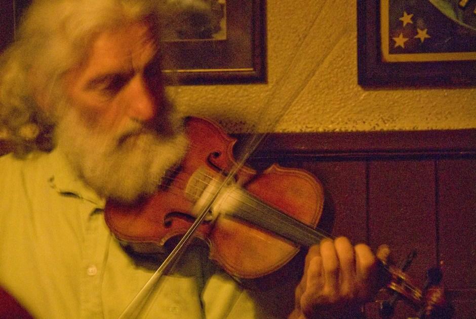 Man playing fiddle in pub, Westport, County Mayo, Ireland
