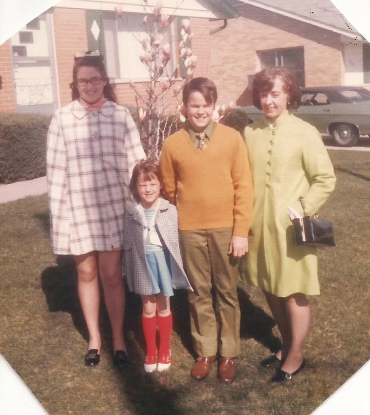 Easter Sunday - around 1970?? - my sister, brother, mom and me (i'm the wee one in those bright red socks!)