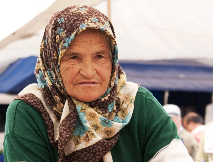 Elderly woman making Gšözleme, a traditional Turkish food, Kalkan, Turkey