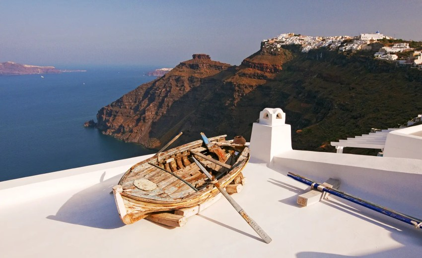 Old wooden rowboat on rooftop, Fira (Thira), Santorini, Greece