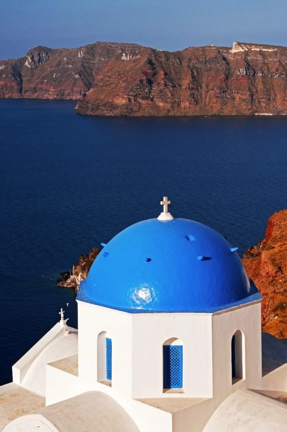 Blue domed church and the Aegean Sea, Oia, Santorini, Greece