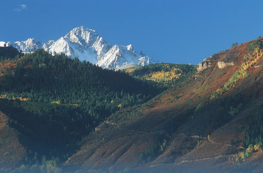Mt. Sneffels under an autumn snow, and above a foggy valley, near Ouray, Colorado, USA