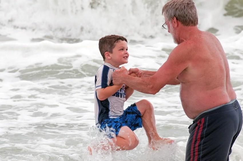 Aidan and Boppa jumping the waves