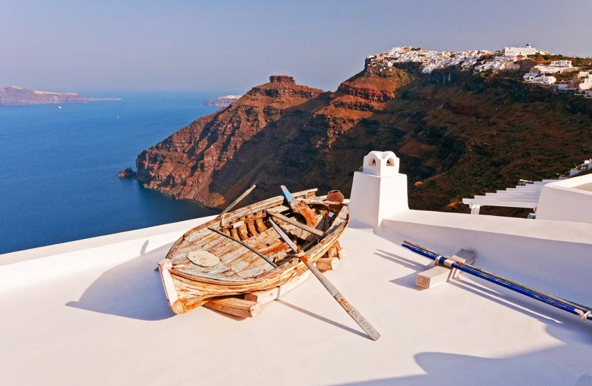 Old wooden boat on rooftop, Fira, Santorini, Greece - one of my dream destinations