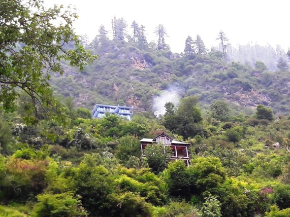 Guest lodges high up in the valley at Tosh