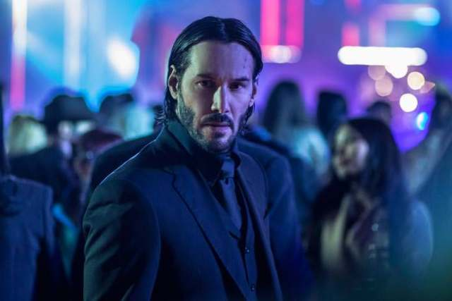 john-wick-goes-walking-his-dog-in-new-photos