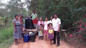 Distributing drinking water in Mahawilachchiya