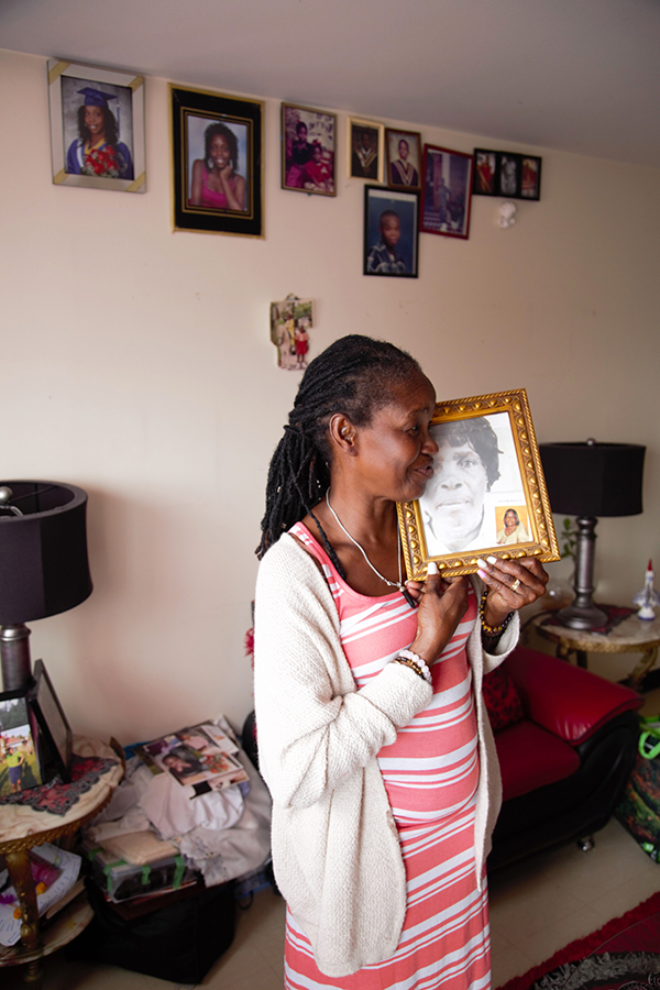 Veronica with a photo of her Mother. Photo credit: James Malekzadeh