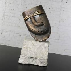 Cast Bronze African Mask Sculpture with Crooked Nose Mounted on Limestone Stand
