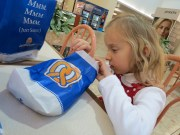 But one the food is there, it's harder. She kept peeking in the pretzel bag while waiting for Daddy to bring the lemonaid.
