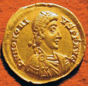 A Roman coin bears the image of Emperor Honorius.