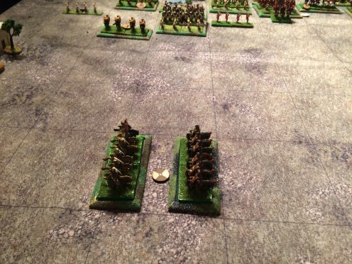 The Left Flank cavalry see a threat forming in the centre, turn to face and then spend the rest of the game failing to move at all towards it.