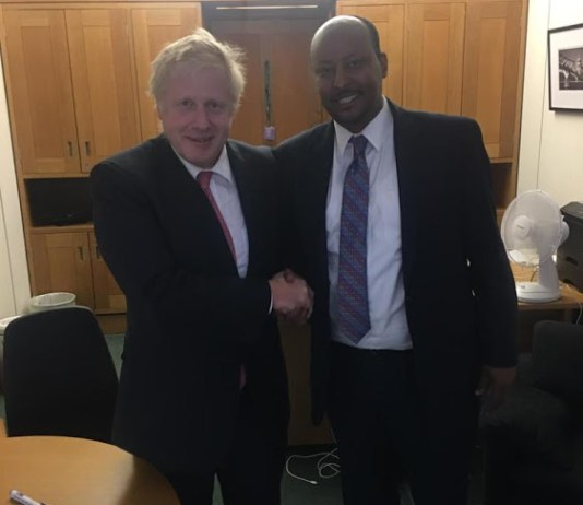 The CEO of Dahabshiil, Abdirashid Duale, with British Prime Minister Boris Johnson