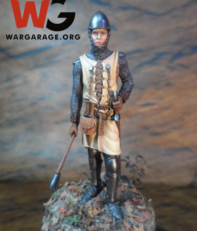 Soldado de infantería de la Baja Edad Medial en ambientación boscosa, nótese los detalles de las hojas secas