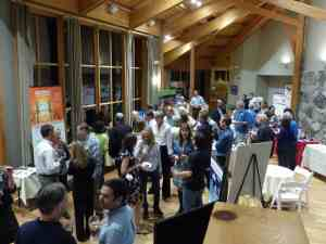 Attendees and Exhibitors enjoying the Friday evening reception