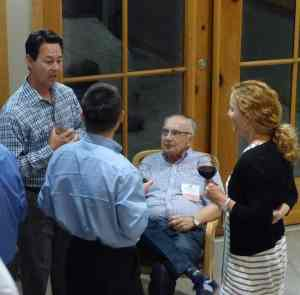 Colleagues network and socialize during the Friday welcome reception