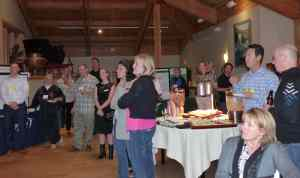 Guests gather to hear announcements at reception