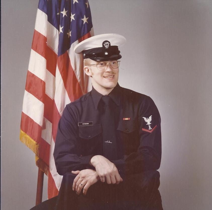 Photographer's Mate 2nd Class (e-5) John Peterson in 1975 at Brunswick, Me., naval air station.