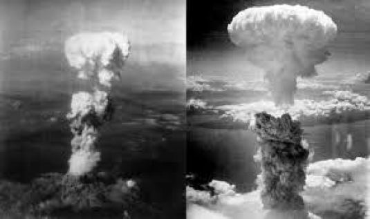 The mushroom clouds signifying the atomic bombings of Hiroshima and Nagasaki.