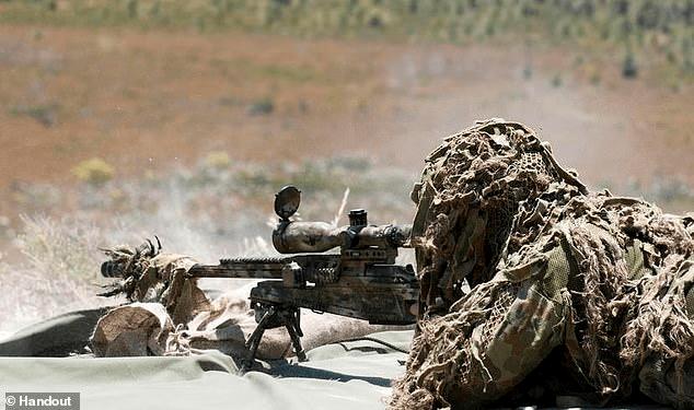 Sniper using a Barrett .50-caliber rifle.