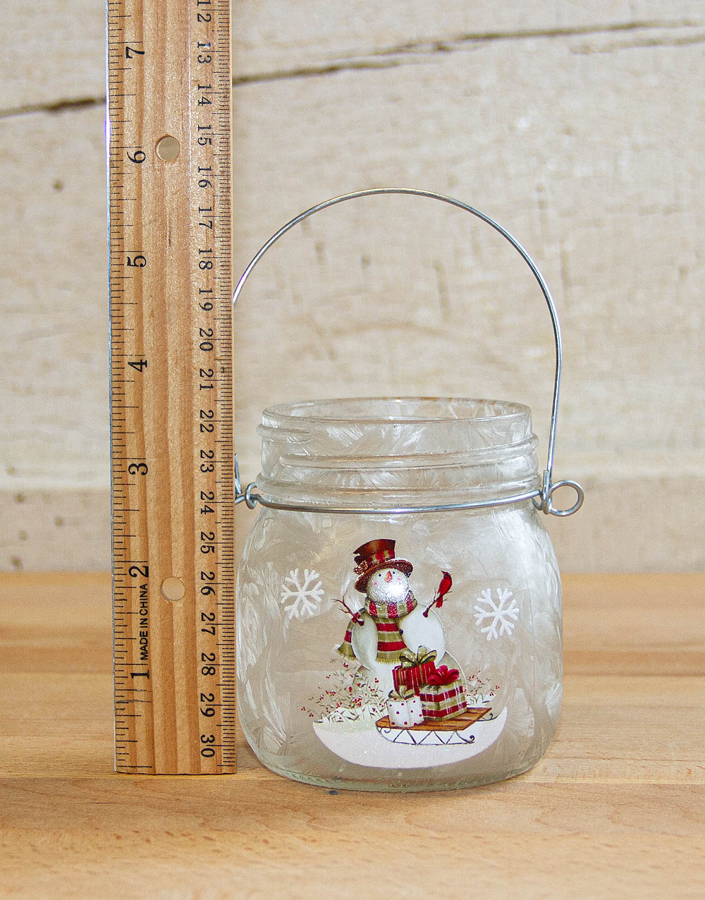 snowman with ruler