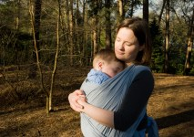 Mother wearing her son in a didymos Robert wrap in Coombe Woods, Croydon. Photographed by Anna Hindocha/Warm Glow Photo