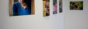 Installation shot of baby wearing photography exhibition at The Portico Gallery by Anna Hindocha/Warm Glow Photo