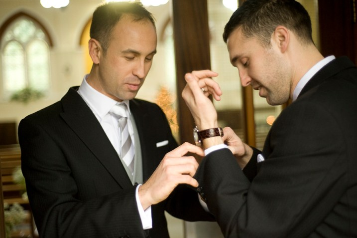 Groomsmen doing cufflinks, New Year's Eve Wedding, St Christopher's Church, Cheam. Photographed by Anna Hindocha/Warm Glow Photo