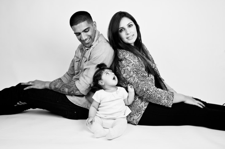 Black and white studio portrait of a baby girl and her parents by Anna Hindocha/Warm Glow Photo