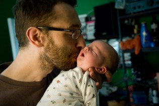 Newborn baby girl with her father photographed by Anna Hindocha/Warm Glow Photo