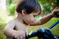 Young boy on bike, Sweden, photographed by Anna Hindocha/Warm Glow Photo.