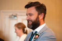 Bride's brother watching magic show, at The Rosendale, Dulwich. Photographed by Anna Hindocha/Warm Glow Photo.