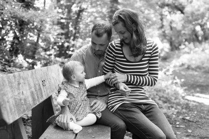 One year old girl with her parents in Sydenham Woods, photographed by Anna Hindocha/Warm Glow Photo