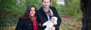 Family with newborn baby on Clapham Common in November. Photographed by Anna Hindocha/Warm Glow Photo