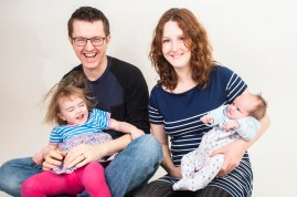 Studio photograph of family with parents, toddler and newborn baby by Anna Hindocha/Warm Glow Photo