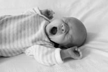 Newborn baby girl yawning photographed by Anna Hindocha/Warm Glow Photo