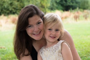 Young girl in party dress with mother in Belair Park, Dulwich. Photographed by Anna Hindocha/Warm Glow Photo