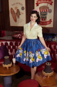Woman in vintage style top and skirt in a bar.