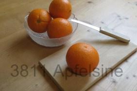 Apfelsinen auf Holz