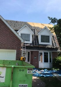 Roofing contractors on site