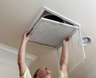 Air filter system in ceiling from Warren Heating and Cooling.